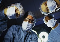 surgeons-looking-at-patient1